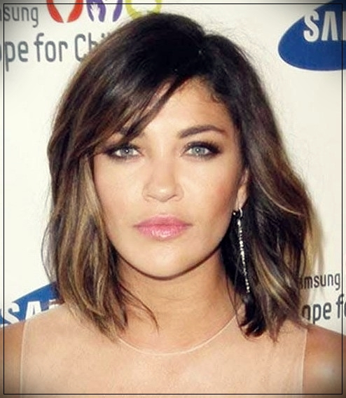 4. Wavy Asymmetrical Long Bob Haircut with bangs
